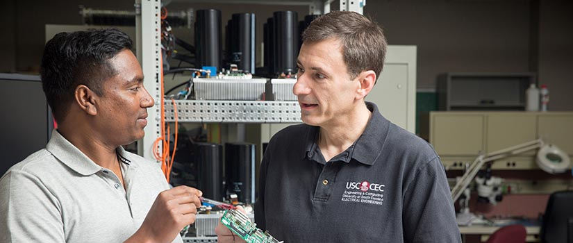 engineering professor working with doctoral student