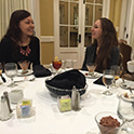 two students talking over a fancy dinner spread