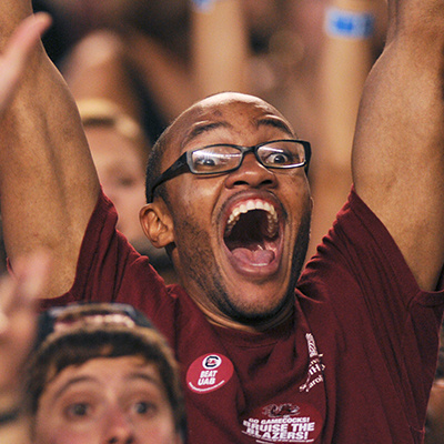student celebrating at sporting event