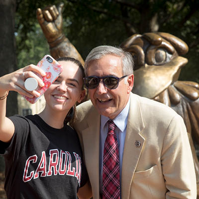student taking selfie with President Pastides
