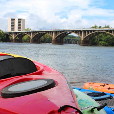 colorful kayaks line the river