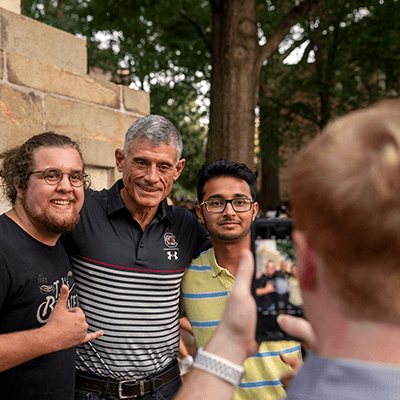 students taking photo with President Caslen