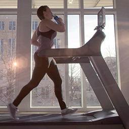 girl running on a treadmill