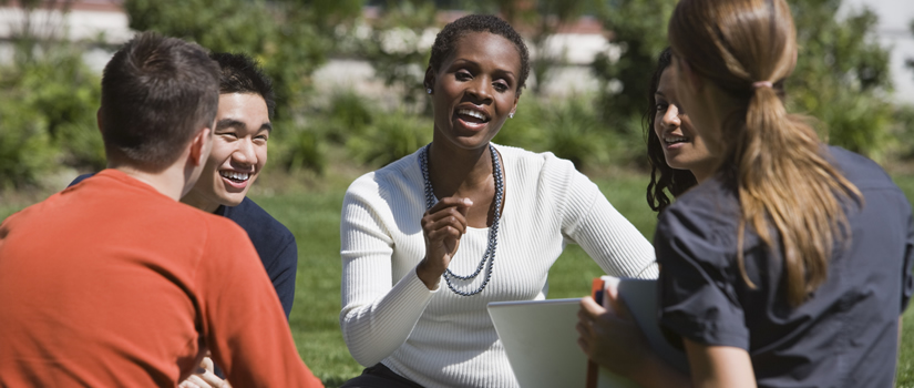 Black Professor on Lawn with Students