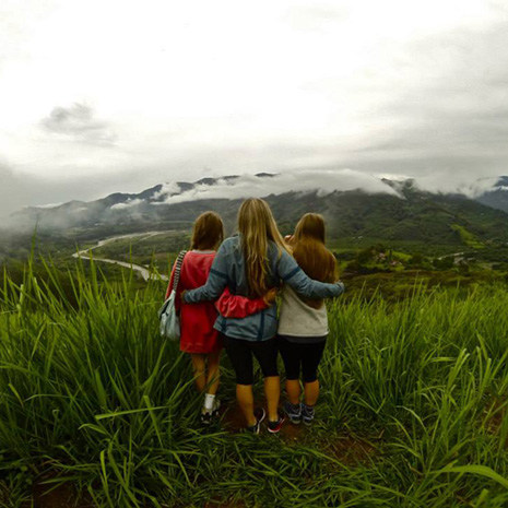 three girls looking at scenery in Costa Rica
