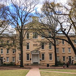In the foreground the historic trees of the horseshoe begin to bloom as Rutledge residence hall is in the background