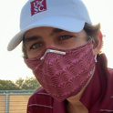 student wearing a gamecock mask
