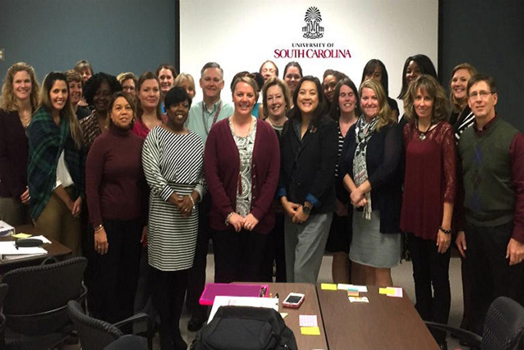UofSC's Lean Community of Practice convenes on a bimonthly basis to strengthen their systems thinking, and sharpen their skills for improving processes. Most of our practitioners are pictured here, following a session of Lean learning, dialogue and practice.