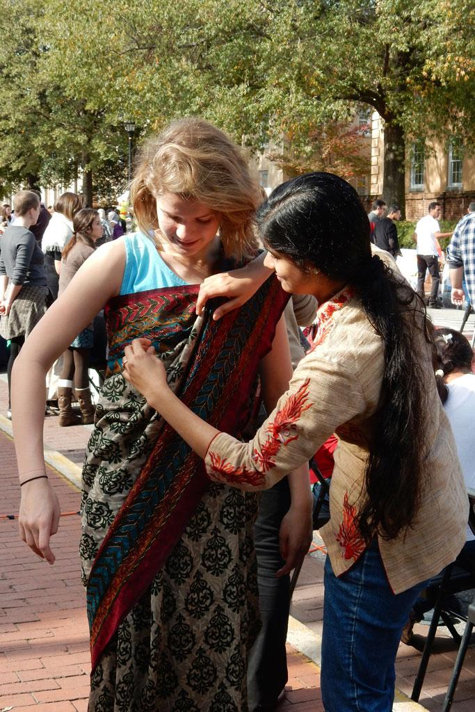 Learn how to dress in a sari at the International Bazaar on Monday, November 14th from 11-2 p.m. on Greene Street!