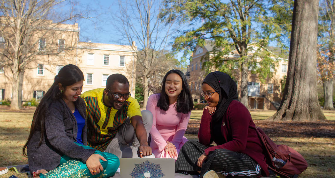 International Students sitting on the Horseshoe
