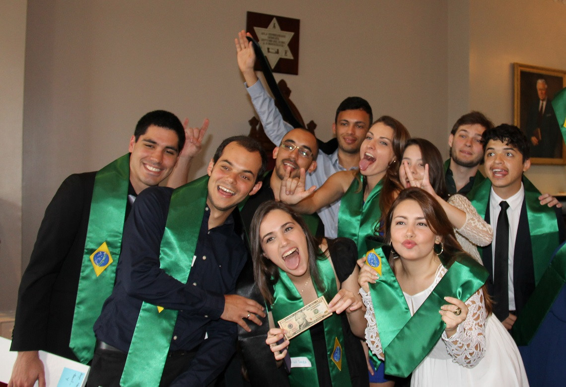 Group of Brazilian students with their graduation sashes.