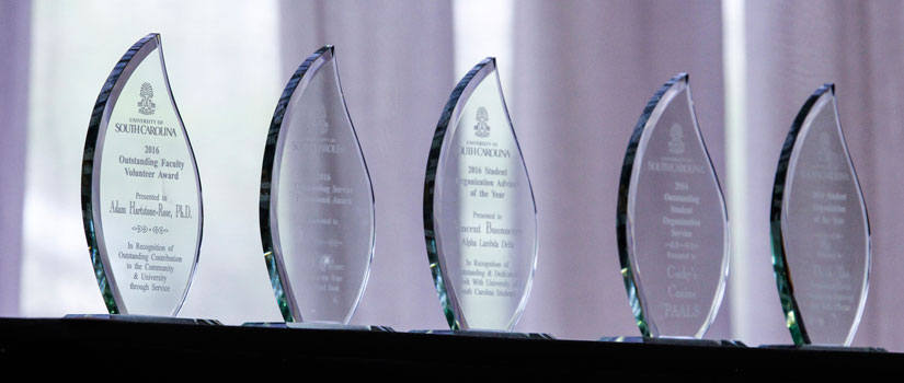 Trophies from previous award ceremonies arranged in a line.