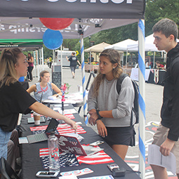 A student talks to other students about voter registration on Greene Street.