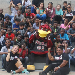 The UofSC Mascot, Cocky, poses with students of all ages.