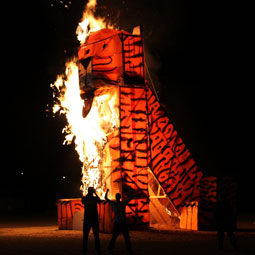 Tiger effigy on fire.