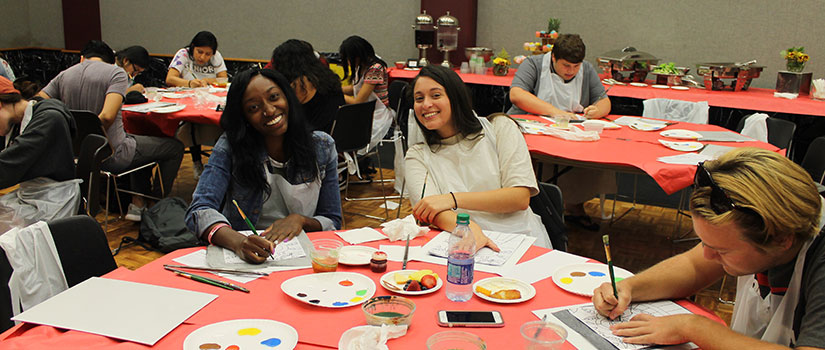 students painting together at an Hispanic Heritage Month event