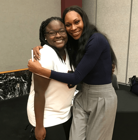 A student poses with Dominique Jackson