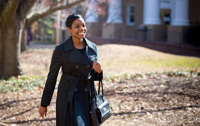 woman walking on campus