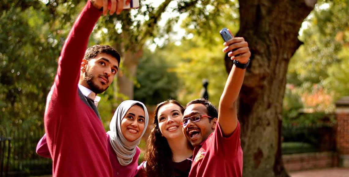 Omani students pose for a selfie
