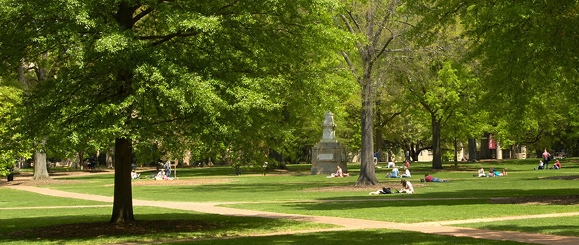 The Maxcy Monument rises from the center of the historic horseshoe surrounded by old trees