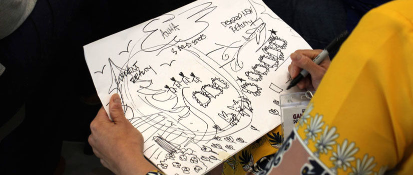 A woman sketches current and new reality in marker pen