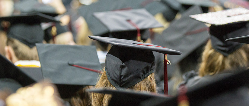 students in graduation hats