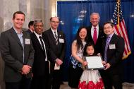 Weyerhauser Harvest Manager Price Barnett, Mechanical Engineering Department Chair Jamil Khan, College of Engineering and Computing Dean Hossein Haj-Hariri, Mechanical Engineering Associate Professor Chen Li and family pose with Governor Henry McMaster at the 2017 Governor's Awards for Excellence in Science ceremony.