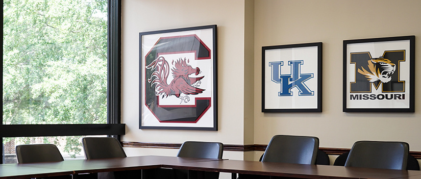 A framed Gamecock sign hangs in the SEC conference room in Russell House.