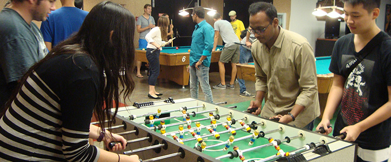 Students enjoying a lively game of foosball in the Golden Spur Game Room.