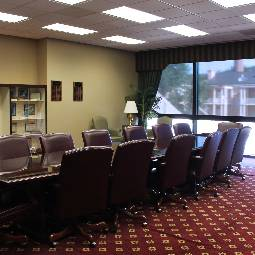 A conference table with comfortable-looking chairs.