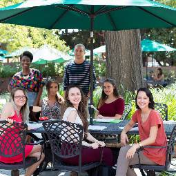 group of students at a patio table