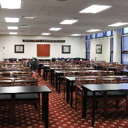 rows of desks in a carpeted room