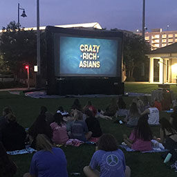 students watching an outdoor movie