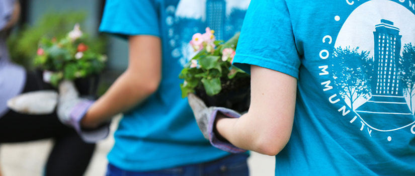 students tend a local garden during Service Saturday
