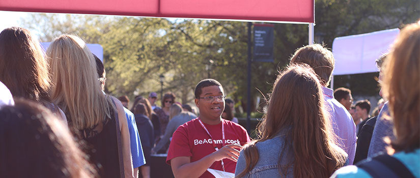 UofSC student interacting with families at an admissions event
