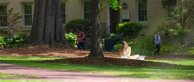 Student studying on USC's historic horseshoe