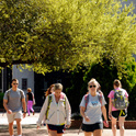 Students walking near USC's Russell House