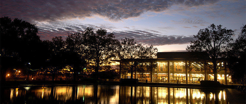 Exterior view of Thomas Cooper Library and fountain during beautiful sunset