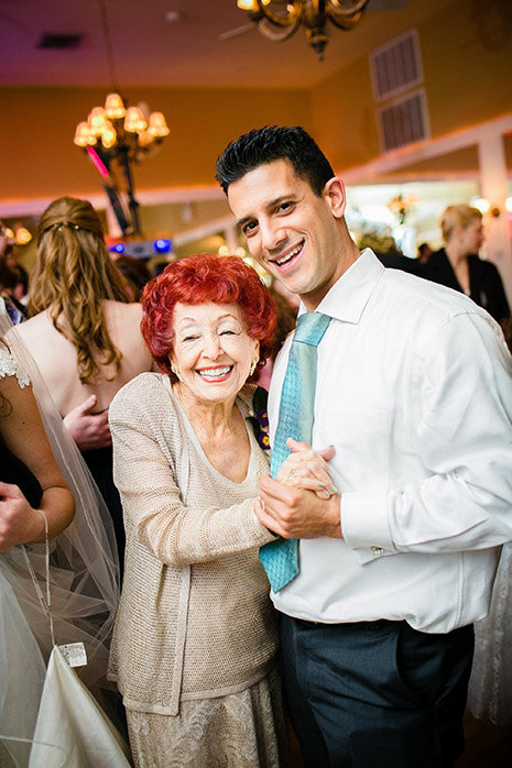 a man and his grandmother dancing