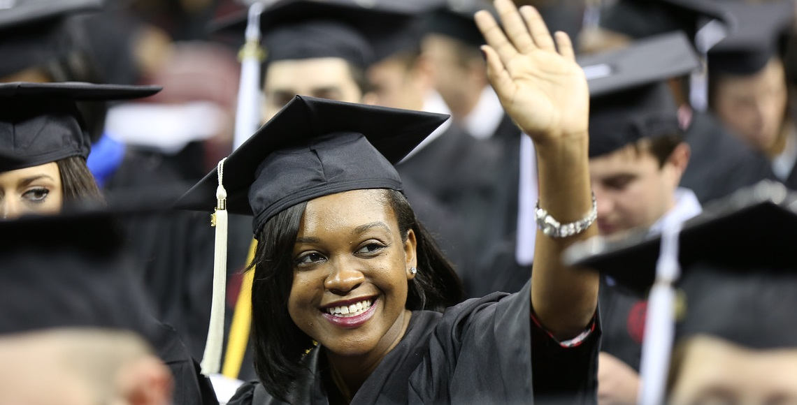 Palmetto College Graduate waves to friends