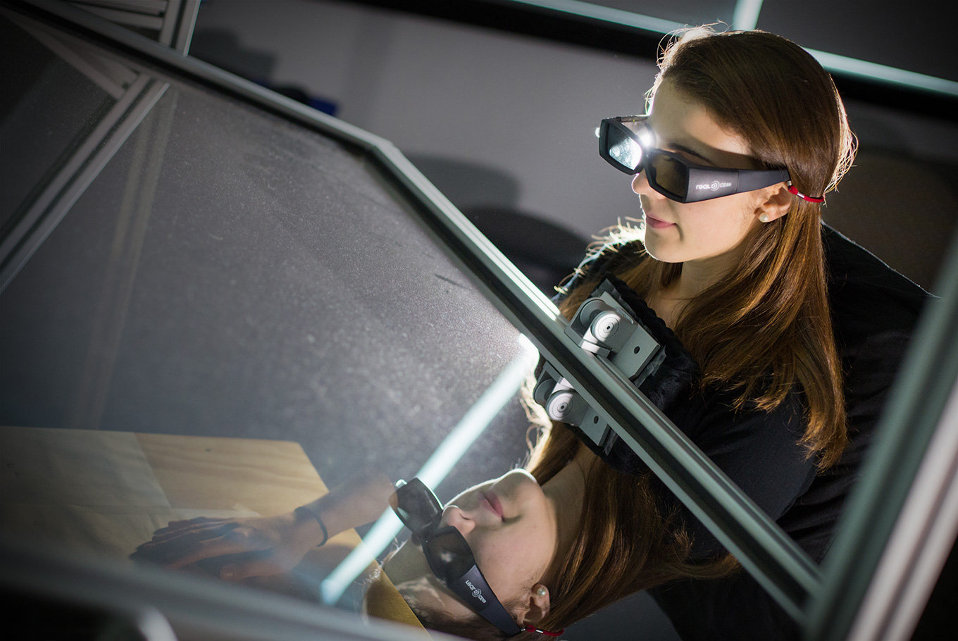 Girl student researching with special 3-D glasses