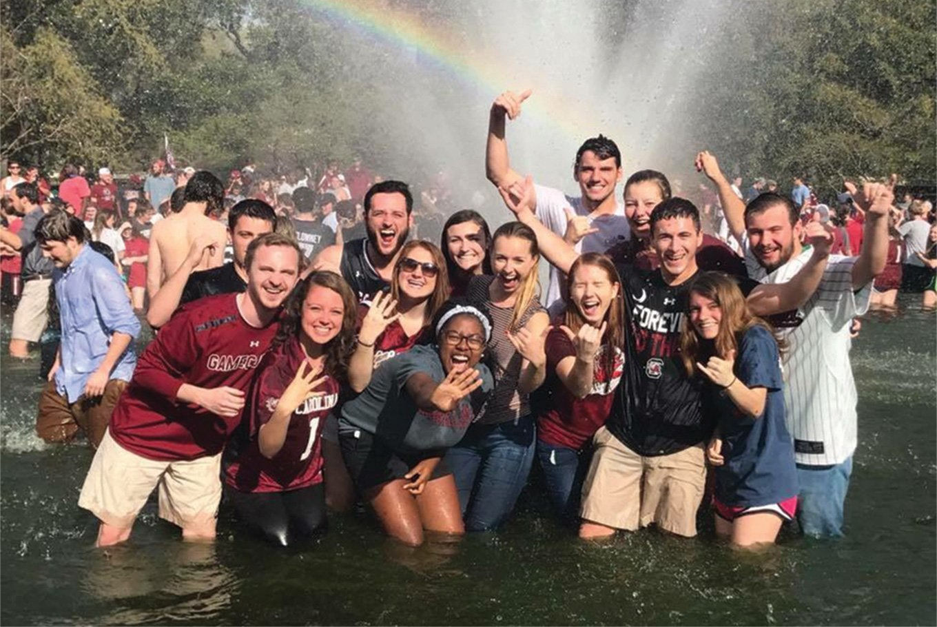 Students celebrating in the Thomas Cooper Library fountain