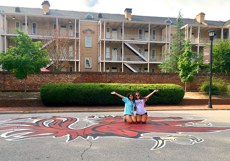 Two students posing in front of Russell House