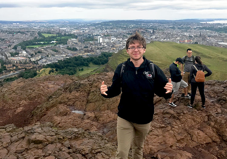 Chase Cunningham standing on top of extinct volcano in Edinburg, Scotland