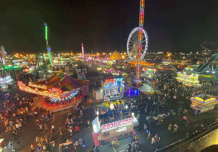 Sky-view of South Carolina State Fair attendees walking at night.