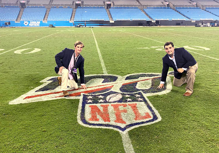 Two journalism students on NFL football field