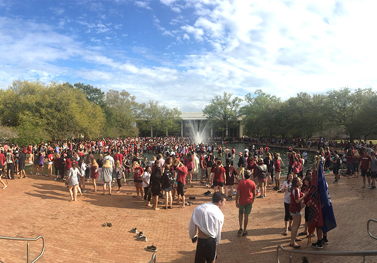 Students celebrating in and near Thomas Cooper Library reflecting pool.