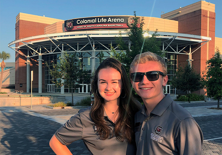 Shannon McDonald and fellow orientation leader in front of Colonial Life Arena