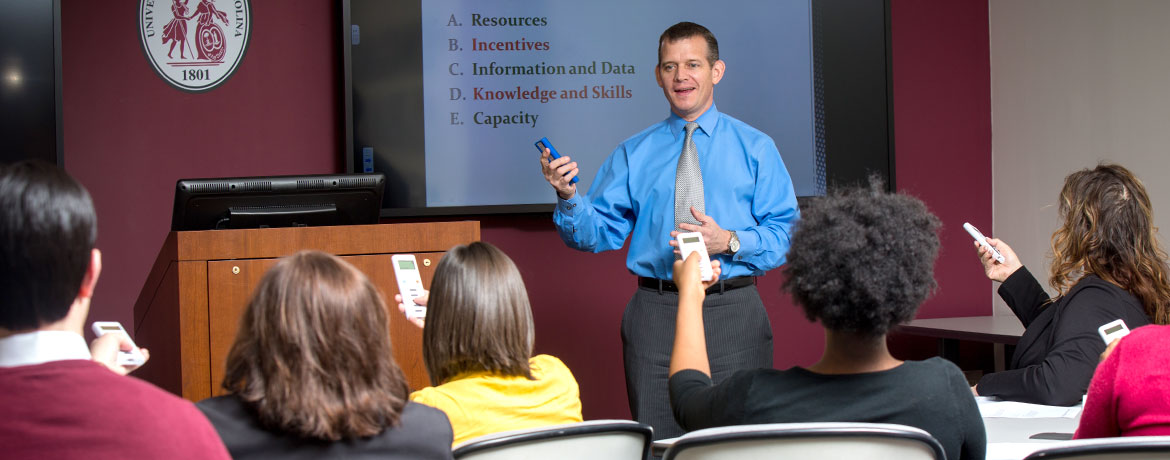 man giving presentation in front of a group