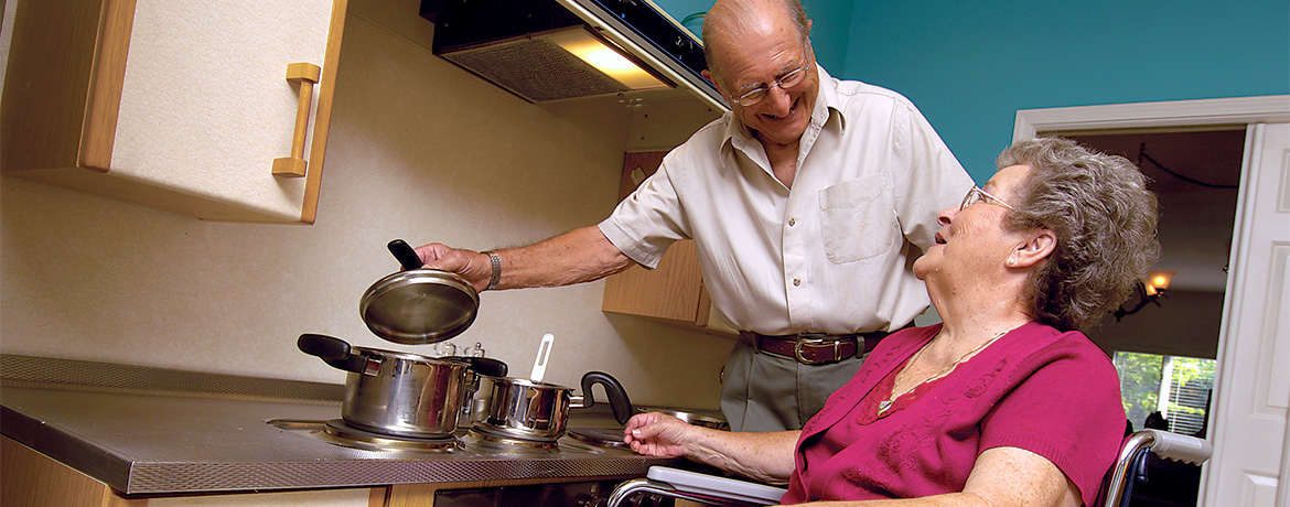 smiling older couple preparing a meal together